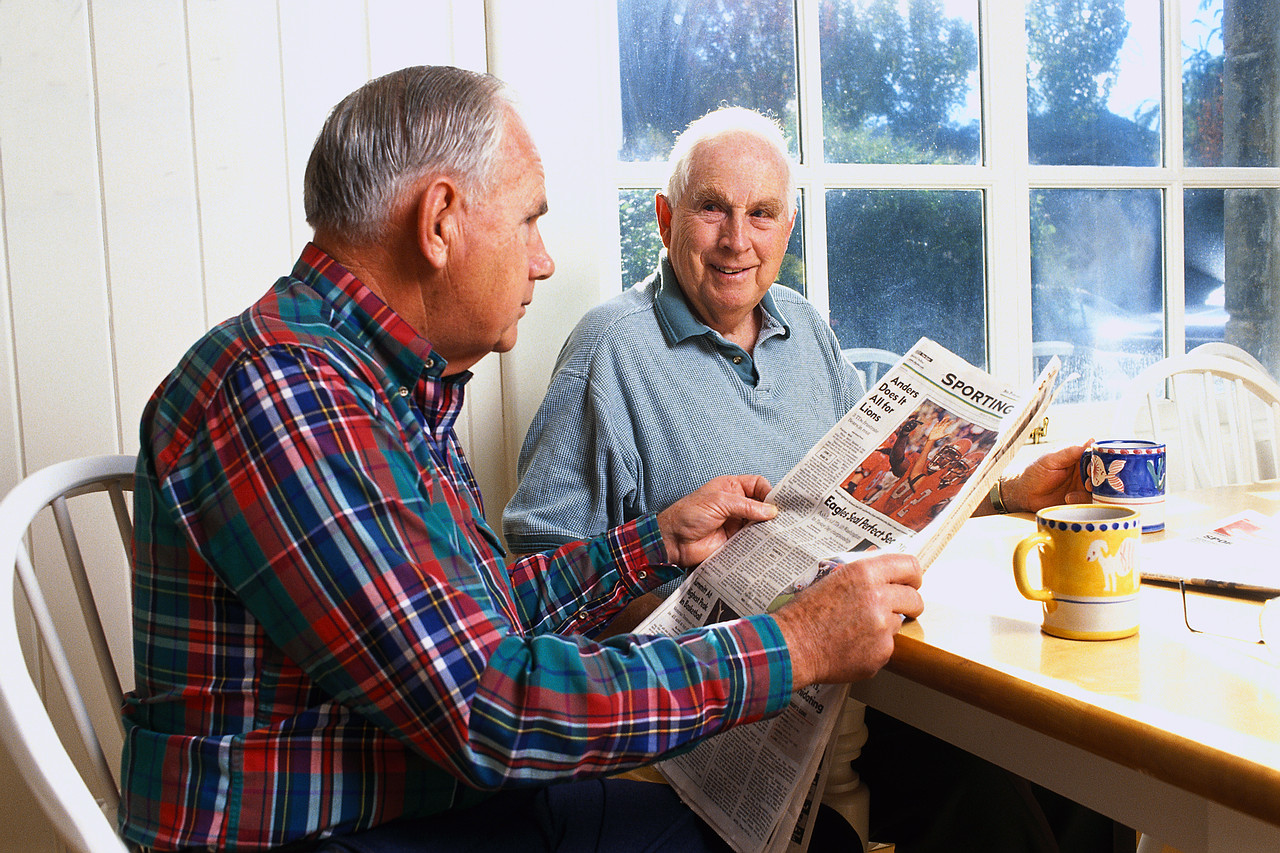 Two Senior Citizens in the Morning reading the newspaper, Green Bay Area Assisted Living, Autumn's Promise News