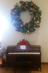 Christmas wreath and piano music for seniors