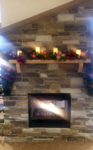 cozy fireplace with holiday decorations in assisted living
